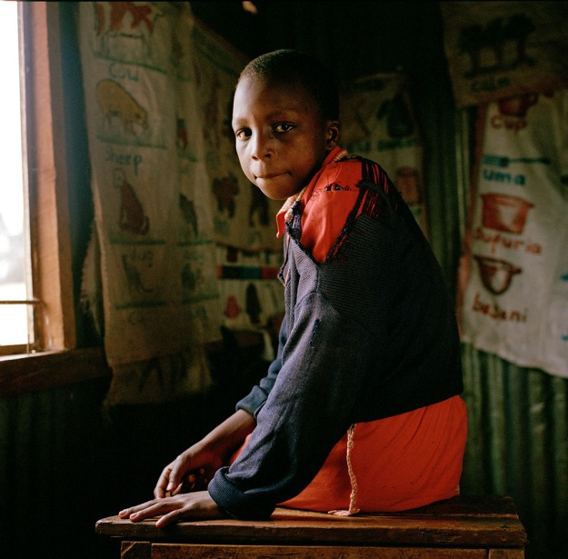 Lucy Wambui (13 ) photographed in one of the classrooms at Attnas Kandie School.